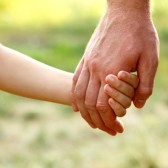 16061977-father-s-hand-lead-his-child-son-in-summer-forest-nature-outdoor-trust-family-concept